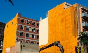 Rehabilitación de fachada medianera con poliuretano proyectado